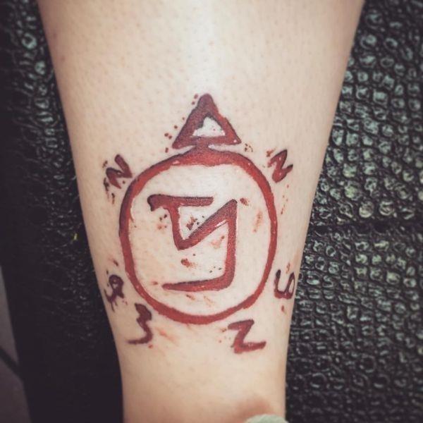 12 %E2%80%9CSupernatural%E2%80%9D red sigil tattoo on the calf
