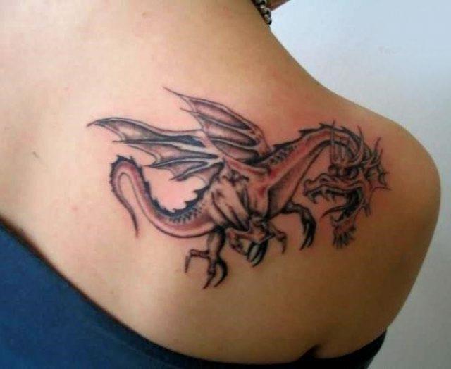 24 tribal dragon tattoo