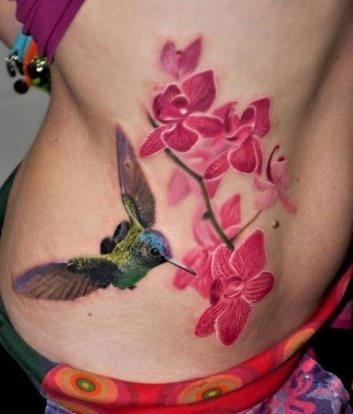 3D Hummingbird With Flowers Tattoo On Side Rib