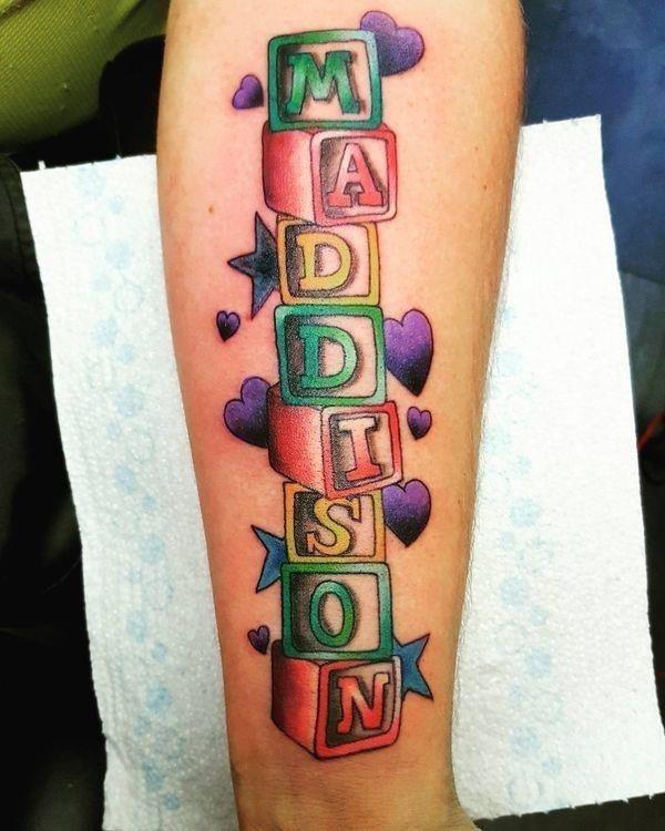 41 children name tattoos on hand