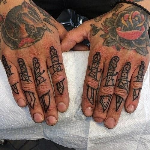 8 dagger sword knuckle tattoos for men with outline black style