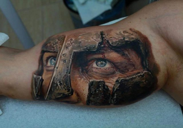 A Roman legionary stares intently in this photo realistic tattoo design