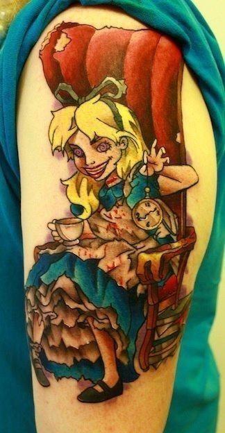 Alice In Wonderland Tattoo On Left Half Sleeve