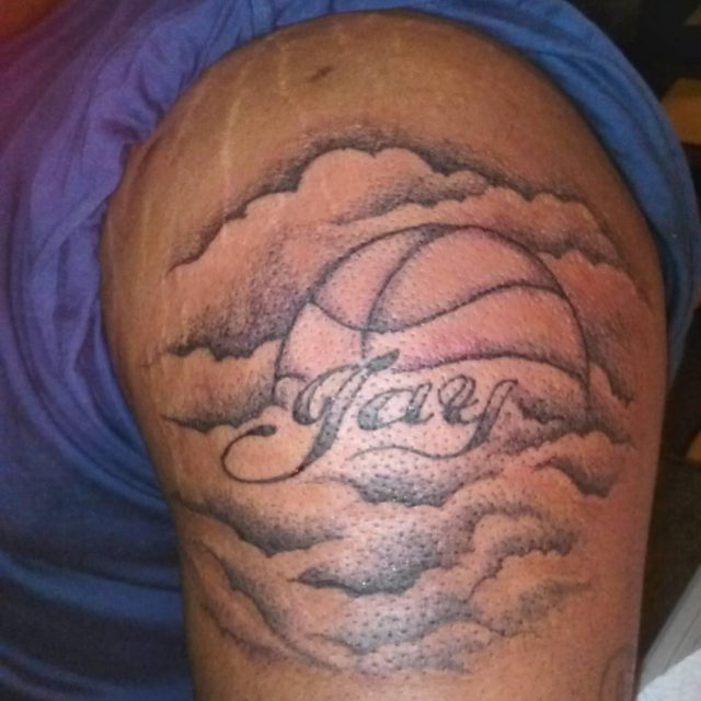 Basketball In Clouds With Hay Text Tattoo On BiceP
