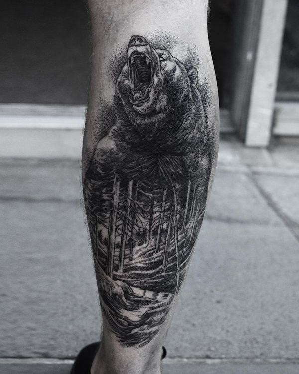 Beautiful blackwork bear tattoo idea on the leg