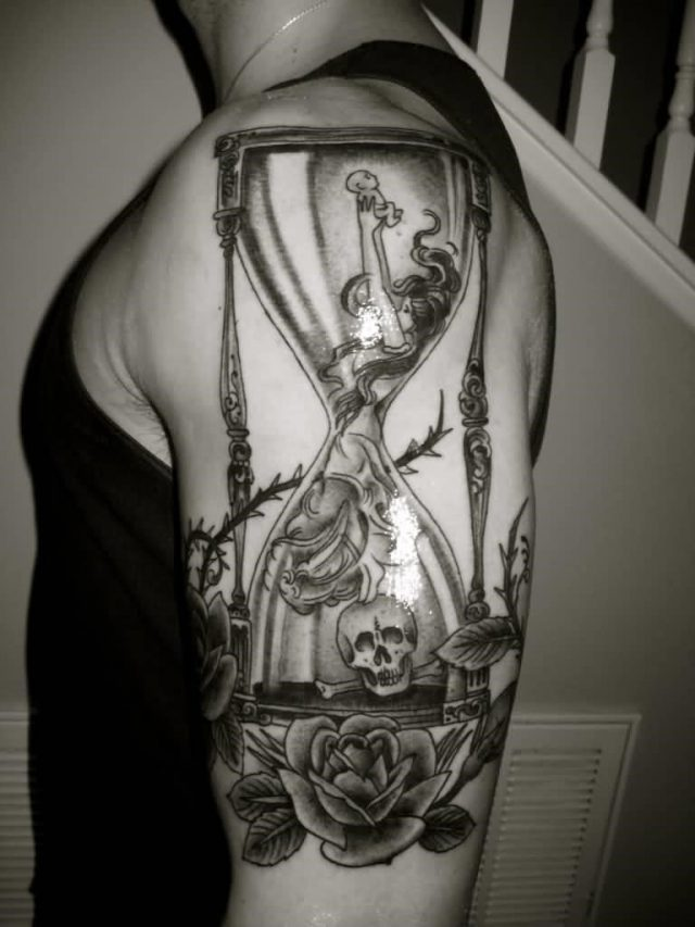 Big Life And Death Hourglass Tattoo On Half Sleeve
