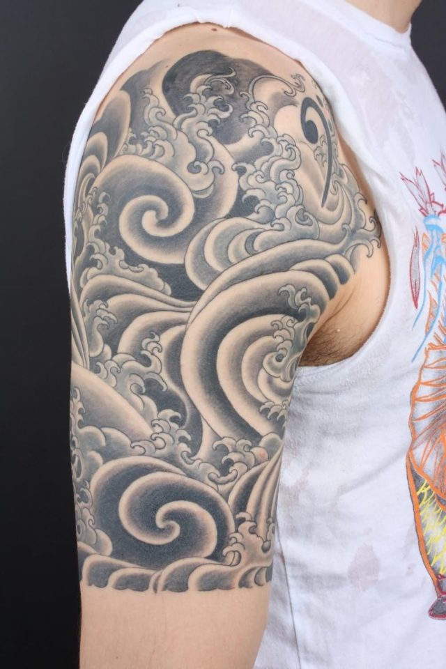 Black And Grey Japanese Cloud Tattoo On Right Half Sleeve