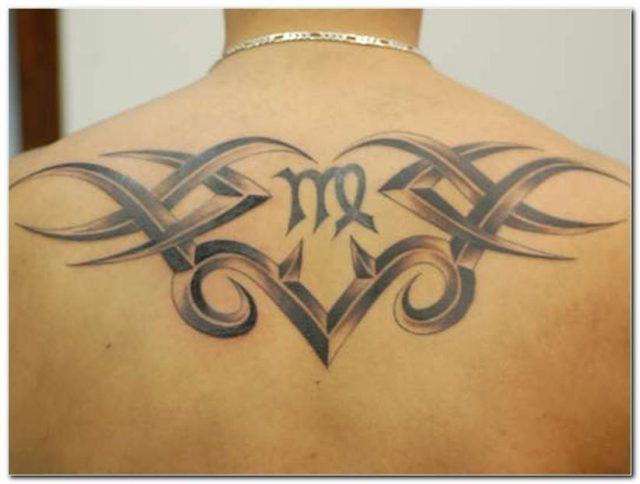 Black And Grey Tribal Virgo Zodiac Tattoo On Upper Back