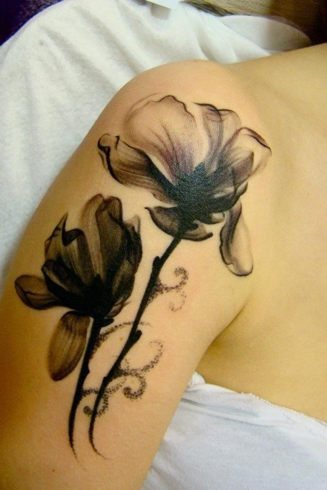 Black And White Two Daisy Flowers Tattoo On Shoulder