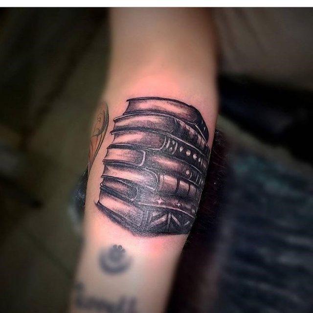 Black Book Tattoo On Sleeve