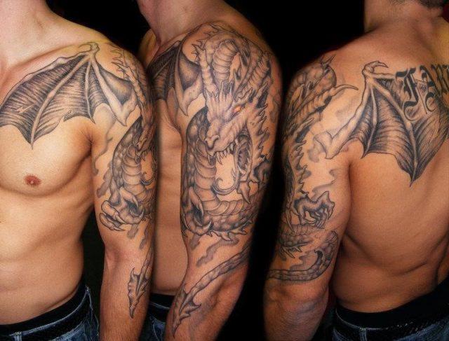 Black Ink Dragon Tattoo On Man Left Full Arm