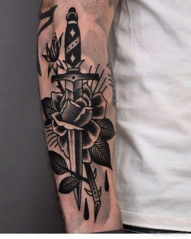Black Rose And Dagger Traditional Tattoo On Arm Sleeve