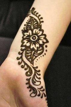 Black Simple Henna Flower Tattoo On Wrist