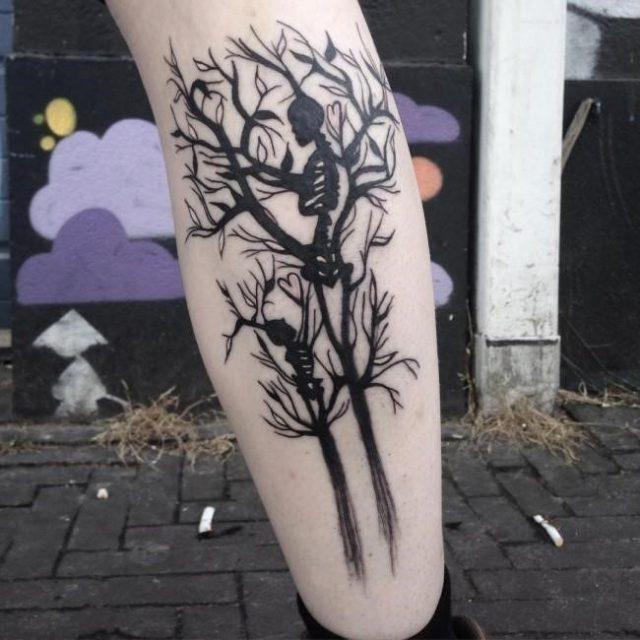 Black Skeleton With Tree Tattoo On Back Leg