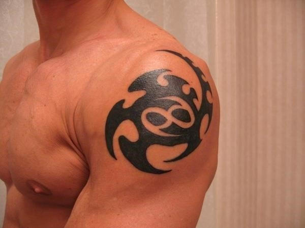 Black Tribal Cancer Zodiac Sign Tattoo On Man Left Shoulder
