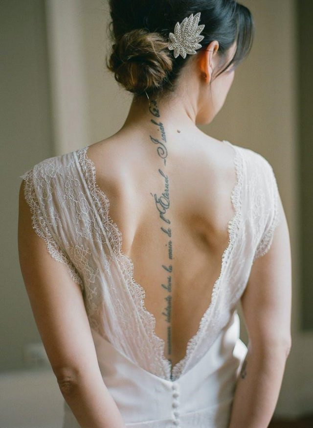 Bride with Spine Tattoo by Greg Finck Photography Script Tattoo Along the Spine Vintage Wedding Elegant Tattoo Ideas