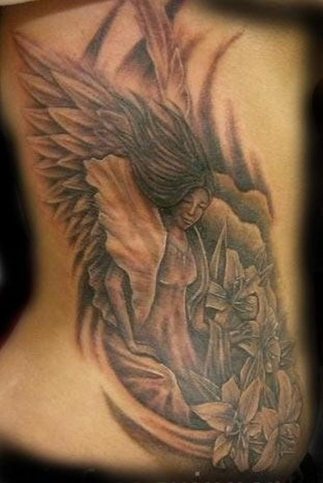 Brilliant Spiritual Angel And Flowers Tattoo