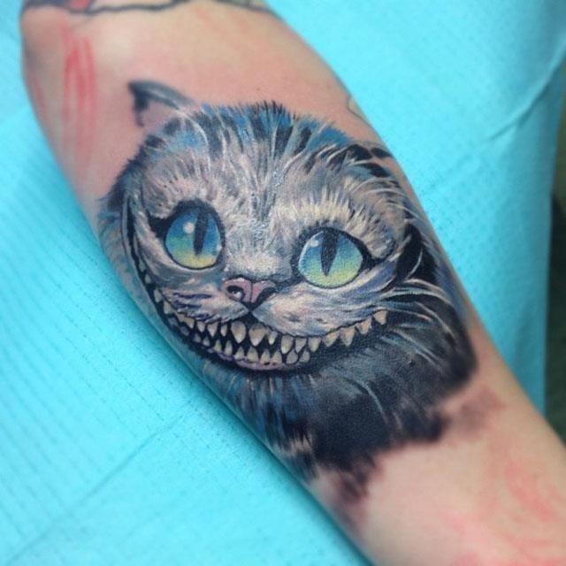 Cheshire Cat Head Tattoo On Arm