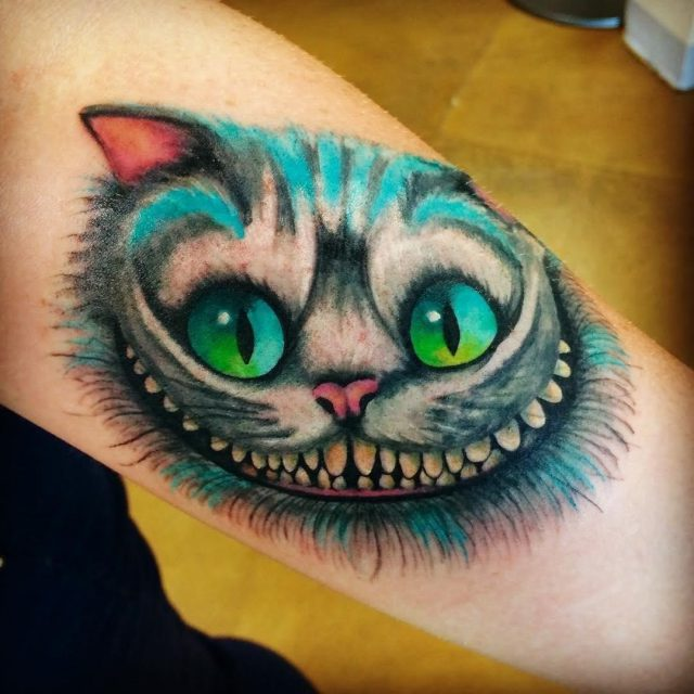 Colorful Cheshire Cat Tattoo On Sleeve