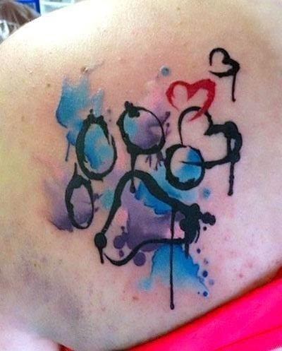 Colorful Dog Paw Print Tattoo Idea