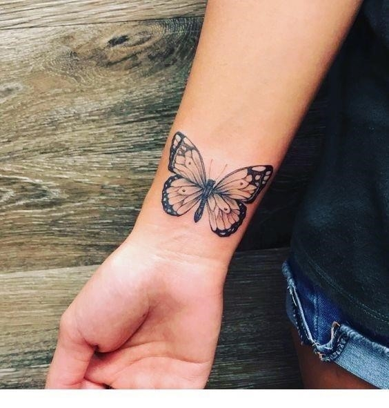 Cute butterfly wrist tattoo