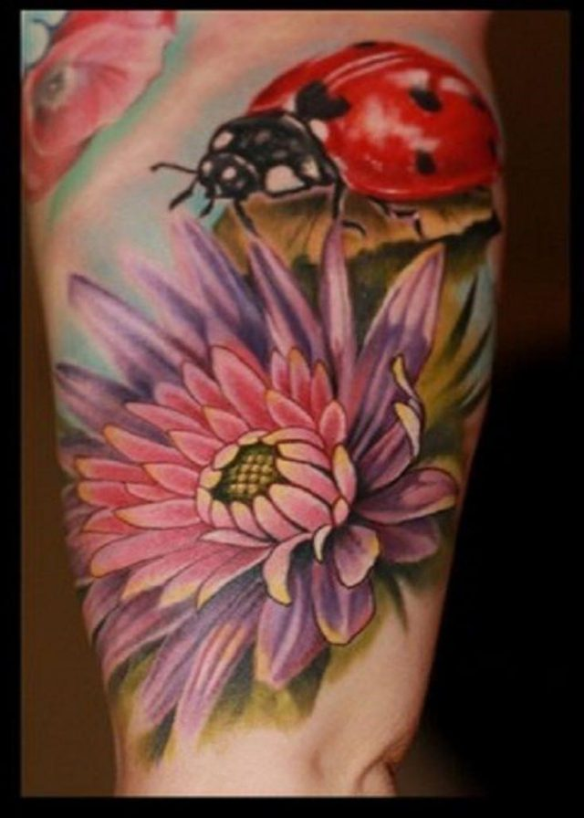 Floral Flowers And Ladybug Tattoo On Inner Bicep