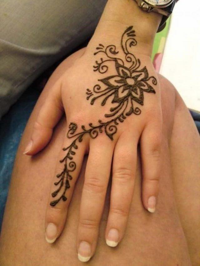 Floral henna tattoo design On Back Hand