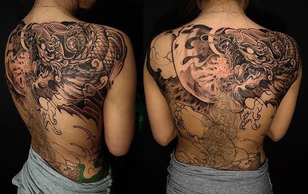 Full back dragon cover up tattoo