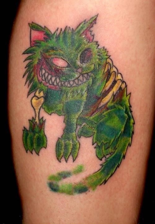 Green Ink Cheshire Cat Tattoo