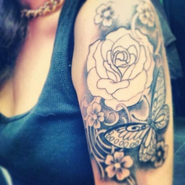 Grey Ink Feminine Flower With Butterfly Tattoo On Girl Left Half Sleeve