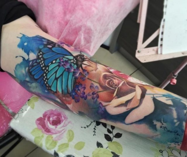 Half sleeve butterfly watercolor tattoo
