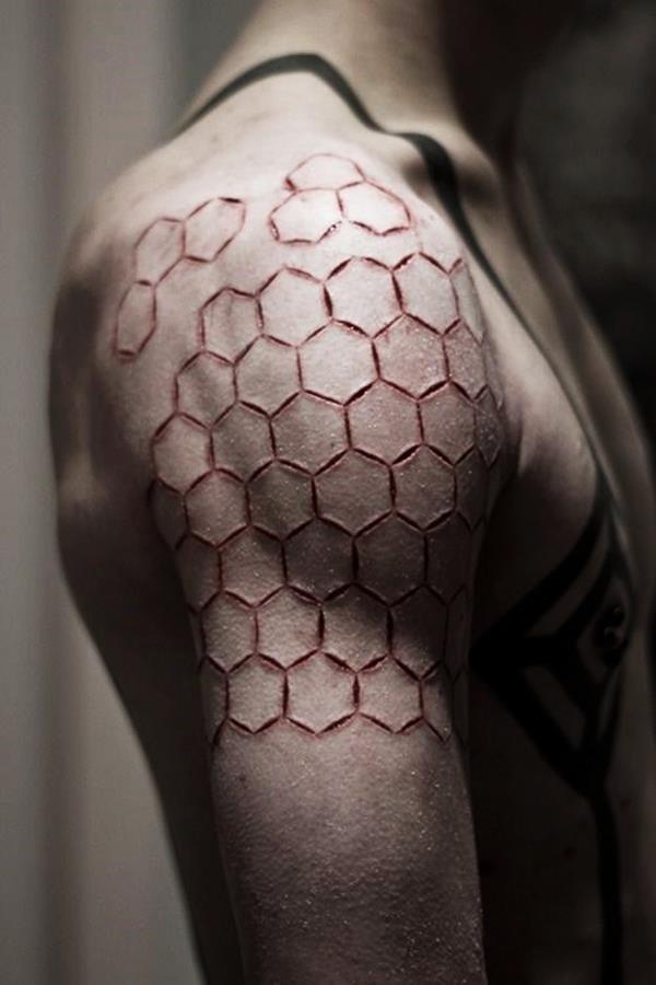 Honeycomb Shoulder Scarification Tattoo
