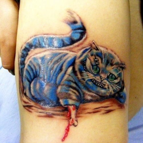 Left Bicep Blue Ink Cheshire Cat Tattoo