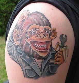 Mechanic Monkey With Spanner Tattoo On Shoulder