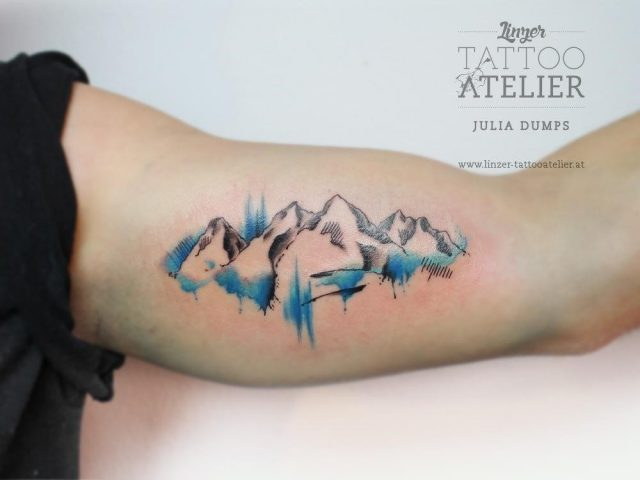 Nice Mountains Watercolors Tattoo On Bicep