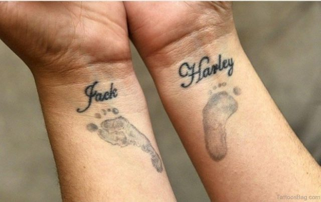Paw And Word Tattoo On Wrist