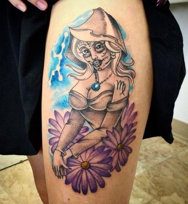 Sexy Virgo tattoo with flowery motive on the thigh