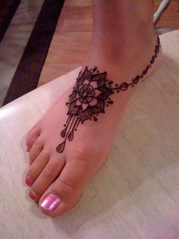 Simple Henna Flower Tattoo On Girl Foot