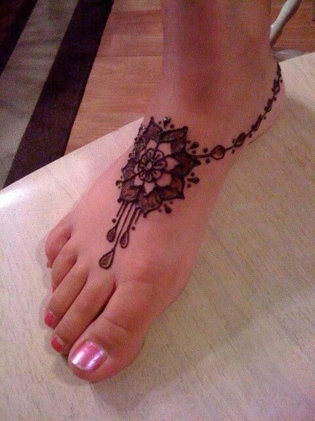 Simple Henna Flower Tattoo On Girl Foot