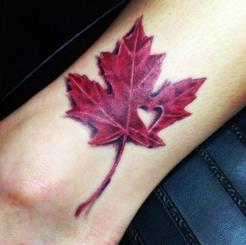 Simple Red Ink Maple Leaf Tattoo On Leg