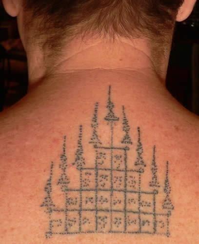 Simple Thai Temple Tattoo On Upper Back