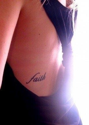 Small Faith Lettering Tattoo On Girl Side Rib