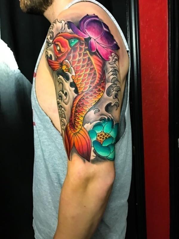 Tattoo of an Orange Koi Fish Swimming Upstream