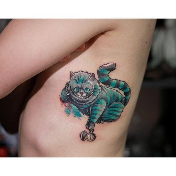 The Cheshire Cat tattoo for ladies on the ribs