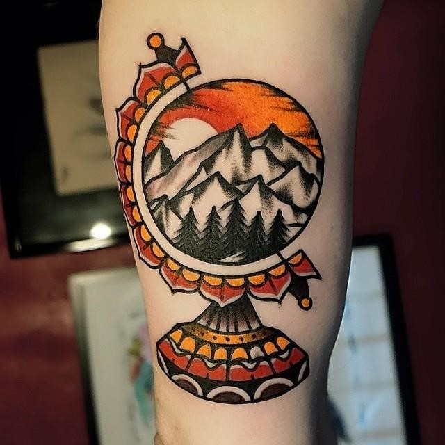 Traditional Mountains On Glob Tattoo