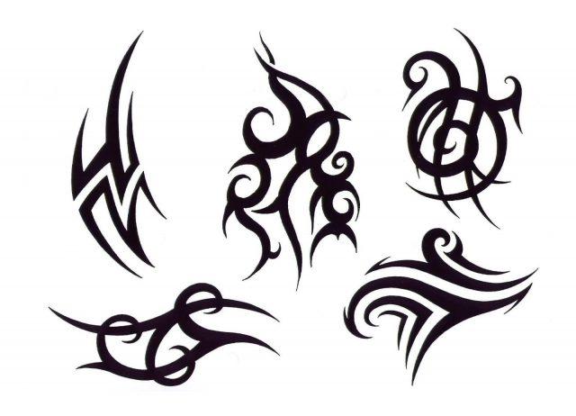 Trendy Black Tribal Tattoos Design