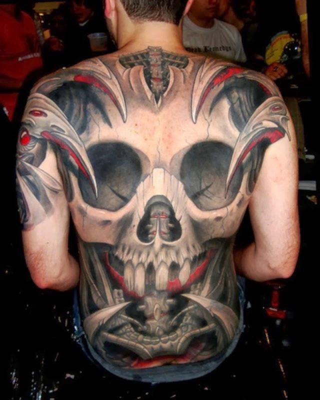 Tribal Skull back Tattoos 1