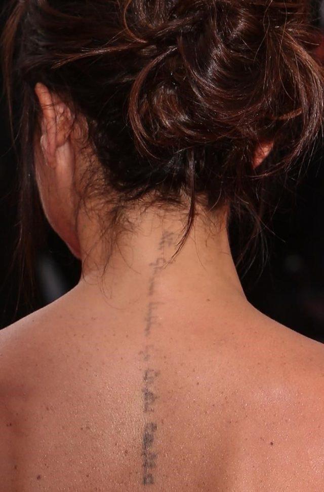 Victoria Beckham Hebrew neck tattoo