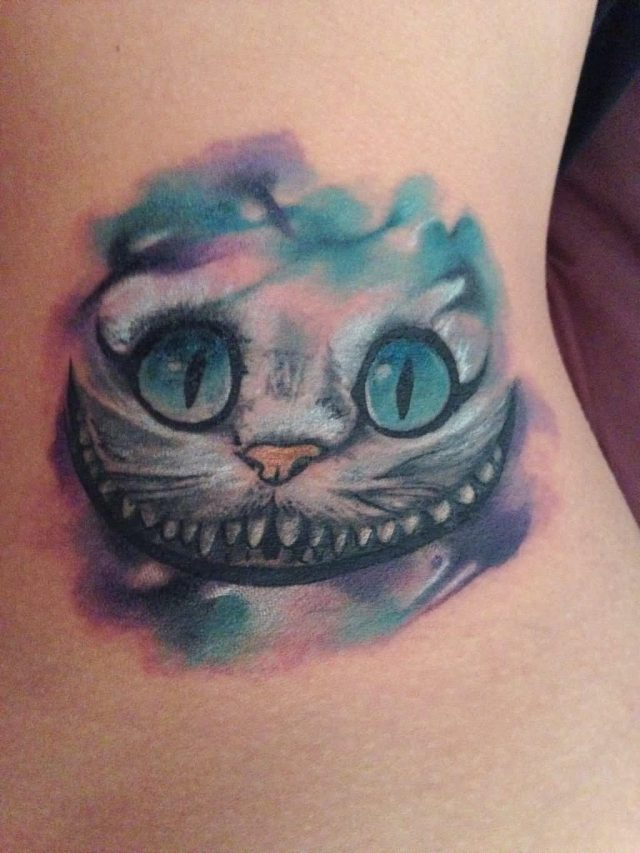 Watercolor Cheshire Cat Face Tattoo