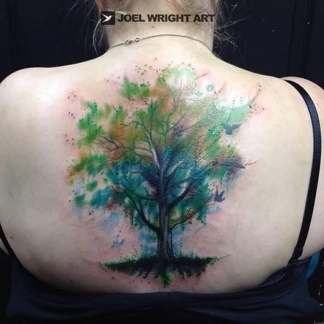 Watercolor Tree Of Life Tattoo On Girl Upper Back